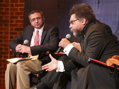 Rajesh Sampath on stage with Cornel West at speaking engagement