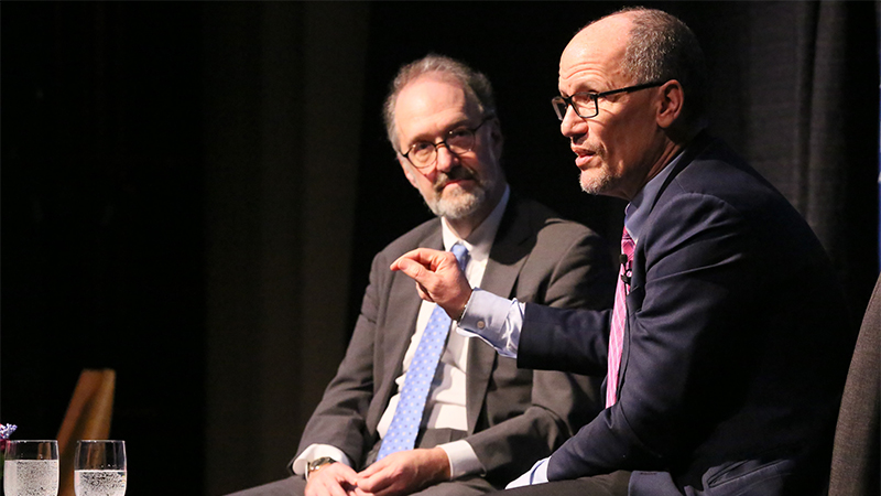 David Weil and Tom Perez on stage