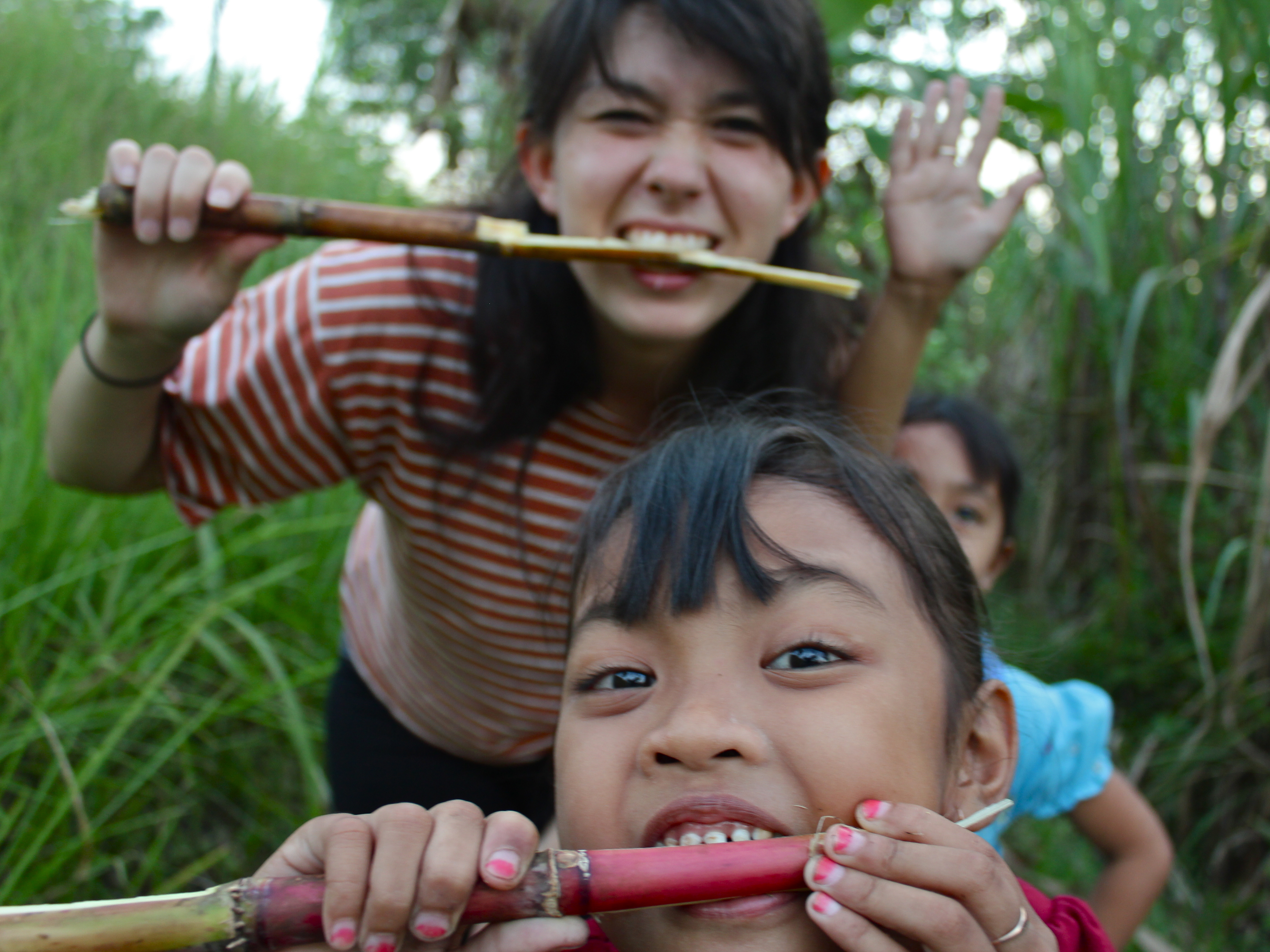 A woman and a child gnawing sugarcane